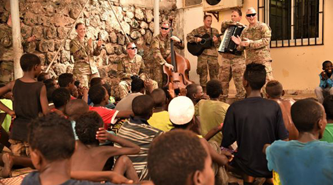 Caritas kids boogie with AFCENT Band in Djibouti